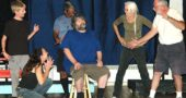 "From left to right, ""sideshow freaks"" Ben McKee, Victoria Walters, Brian Upchurch, Ali Thomas and Joshua Hayward loom around Ben Cronan, seated, who plays Mr. Cooger in Yellow Springs Theater Company's production of Ray Bradbury's ""Something Wicked This Way Comes."" The play features a number of odd locations and weird characters, an appealing feature for the actors involved. Opening night is Friday, Oct. 14, at 8 p.m., at the First Presbyterian Church. (Photo by Dylan Taylor-Lehman)"