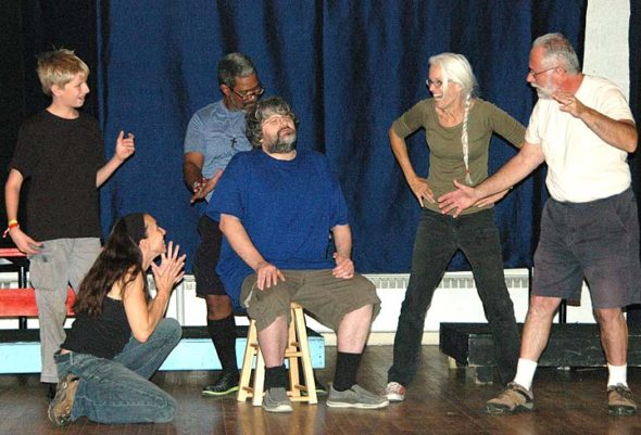 """From left to right, """"sideshow freaks"""" Ben McKee, Victoria Walters, Brian Upchurch, Ali Thomas and Joshua Hayward loom around Ben Cronan, seated, who plays Mr. Cooger in Yellow Springs Theater Company's production of Ray Bradbury's """"Something Wicked This Way Comes."""" The play features a number of odd locations and weird characters, an appealing feature for the actors involved. Opening night is Friday, Oct. 14, at 8 p.m., at the First Presbyterian Church. (Photo by Dylan Taylor-Lehman)"""