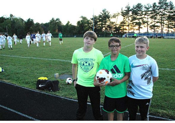 Ball boys Jason Knemeyer, Eli Eyrich and Josh Clark stood at attention at the Bulldogs game against the Columbus International Lions. The ball boys were tasked with patrolling the perimeter of the game and throwing balls to the players or referees when it was needed. They also filled this reporter in on the strategy of the game, which the Bulldogs won 7–1. (Photo by Dylan Taylor-Lehman)