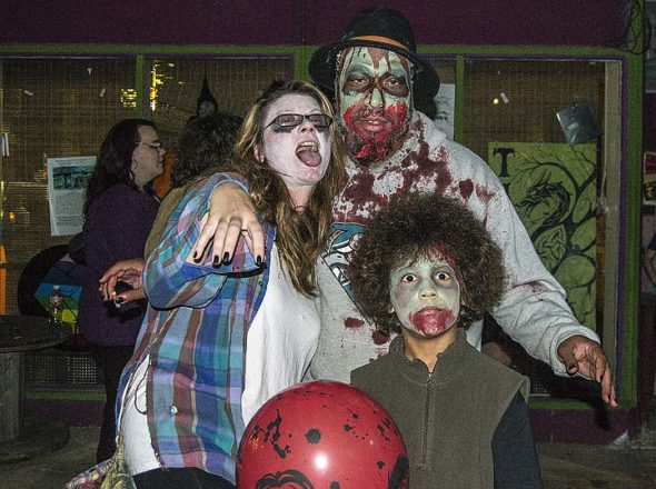 Zombie family Char Toms, Steve McQueen and Jayden Toms, left, roamed Corry Street in downtown Yellow Springs this past Saturday at the 8th annual family-friendly Zombie Walk. (Photos by Isaac Delamatre)