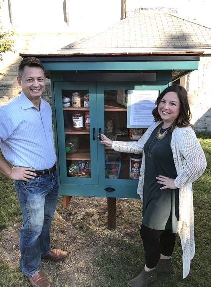 Kimberly Horn with husband, Kriston, standing by the new Free Little Pantry on Walnut Street. (submitted photo)