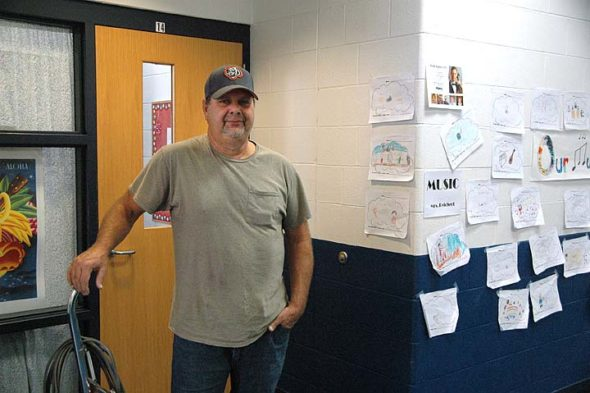 Yellow Springs school district's long-time custodian Jerry Upton is retiring after 30 years on the job. His tenure with the school has had him driving buses, doing groundskeeping work and working in long-gone buildings. He has learned in a number of different skills via a number of different positions, and still gets greeted warmly by students who have long ago graduated. (Photo by Dylan Taylor-Lehman)