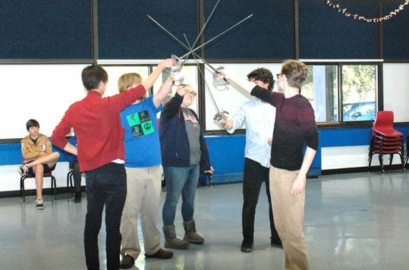 """From left, YSHS actors Jonah Trillana (Aramis), Windom Mesure (Athos), Allison Bothwell (Sabine), Grant Crawford (D'Artagnan) and Duard Headley (Porthos) at a recent rehearsal of """"The Three Musketeers,"""" the high school's fall play. Alexandre Dumas's classic swashbuckling comedy, updated with a feminist twist, will be performed this weekend and next. (Photo by Audrey Hackett)"""