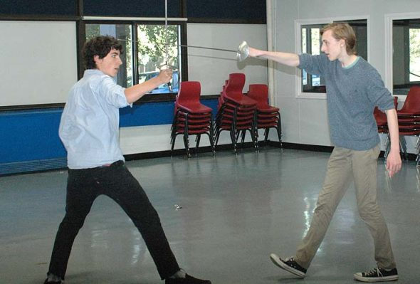 """Grant Crawford and Duard Headley recently rehearsed a swordfighting scene from the YSHS fall play, """"The  Three Musketeers,"""" which takes place this weekend and next at the Mills Lawn gym."""