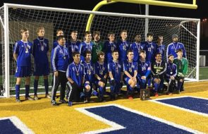 """The Yellow Springs Bulldogs pose with their hard-earned district championship trophy, which they earned last week after beating conference rivals Dayton Christian 1–0. """"Our boys wanted it more than them,"""" said coach Ben Van Ausdal. """"They feel like they could beat anybody right now.""""The team unlocked the next level of tournament play, and will be fighting tooth and nail this week for victory at the regional semi-finals. (Submitted photo)"""
