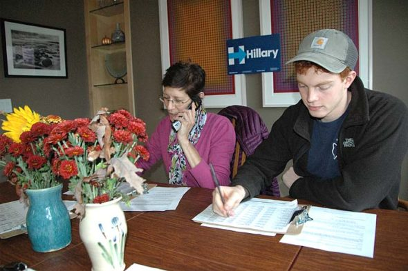 Clinton campaign volunteers Luan Heit and Nick Barton of Xenia were among about 11 volunteers making get-out-the vote phone calls for their candidate last week. Organizers say several hundred villagers have volunteered for the campaign. (Photo by Diane Chiddister)