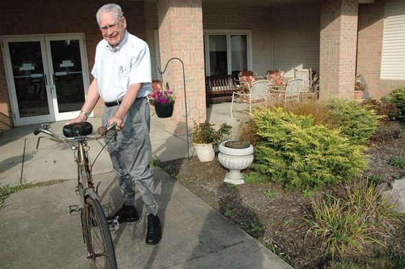 "Carl Hyde, who moved into the Friends Assisted Living Center a year ago, first came to Yellow Springs as an Antioch College freshman more than 70 years ago. After more than four decades as a town physician, he's known to many as ""Dr. Hyde."" He rides his bike regularly in good weather. (Photo by Diane Chiddister)"