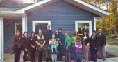 Pictured at the Home, Inc., Open House are, from left: Miller Fellow Monika Perry, AmeriCorps VISTA volunteer Cait Bothwell, Development Coordinator Brittany Parsons, homeowners Elizabeth and Matthew Schaade, homeowners Brandy and Patrick Hange with children Nico and Nolan, homeowner Erica Wyant with daughter Rudelle Mae, homeowner Julie McCowan, Miller Fellow Kyna Burke, Executive Director Emily Seibel and Program Manager Chris Hall. (Submitted Photo)