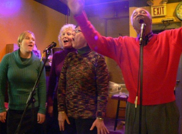 WinterSong Encore is happening this Saturday, Dec. 3, at First Presbyterian Church. Music begins at 7 p.m. Pictured are singers from the 2010  event, previously held at the Emporium, including, from left, Jeanna GunderKline, Molly GunderKline and Jim Felder. (Photo by Susan Gartner)