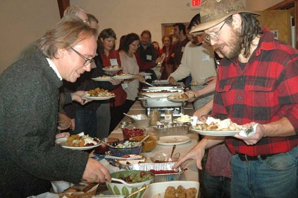 Michael Harrod, left, and John Fudge, right, were two of the many villagers, families and friends who took part in last Thursday's Community Thanksgiving at the First Presbyterian Church. (Photos by Diane Chiddister)