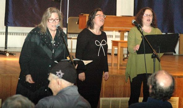 "From left, Lori Askeland, Amy Magnus and Jennifer Gilchrist, performing as Fire Horse Trio, harmonized to a packed house at WinterSong Encore at First Presbyterian last Saturday. Emceed by ""Elder Felder"" Jim Felder, who also thrilled audiences with several songs, the event featured more than 20 local musicians and singers, and included a stirring version of Leonard Cohen's ""Hallelujah"" sung by David Walker, with Brian Walker on keyboard and Jeanna GunderKline on backup vocals. (Photo by Audrey Hackett)"
