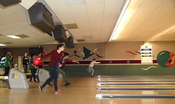 "Lilly Bryan, Jonah Trillana and Kallyn Buckenmeyer tried for strikes at Beaver-Vu lanes last week during one of the YSHS's bowling team's practices. Bowling is a new sport at the high school this season, with 14 students on the team. ""Bowling is one of the best things anyone can do,"" said coach Matt Cole. ""I've never known anyone who's had an awful time bowling."" (Photo by Dylan Taylor-Lehman)"