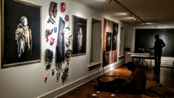 """""""Living in Divided States"""" exhibition installation with UD artist Issa Randall and co-curator, Rodney Veal. The exhibition opens on Dec. 8. (Submitted photo)"""