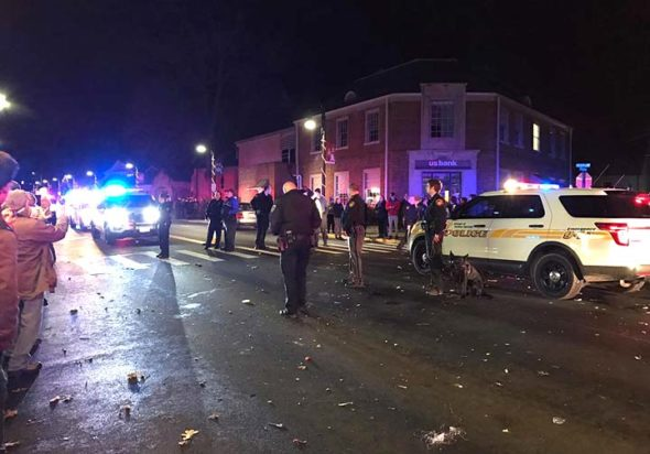 Police from at least six municipalities and agencies joined Yellow Springs police in a presence downtown on the New Year's Eve Ball Drop that many villagers found hostile and aggressive. (Photo courtesy of Margaret Kinner Fischer)