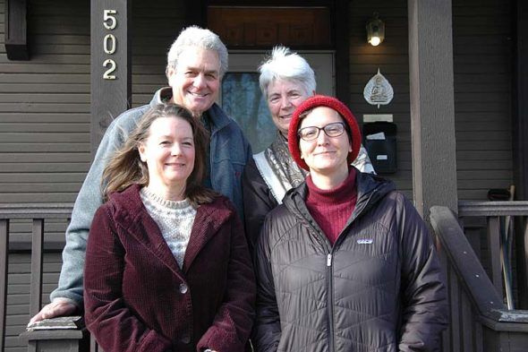 """The Dharma Center and Community Solutions are partnering to offer an """"eco-sattva"""" training beginning Jan. 12 to help villagers take mindful, effective action in response to climate change. Pictured outside the Dharma Center are, counterclockwise, course facilitators Saul Greenberg, Dione Greenberg and MJ Gentile, with Dharma Center Board Member Katie Egart. (Photo by Audrey Hackett)"""