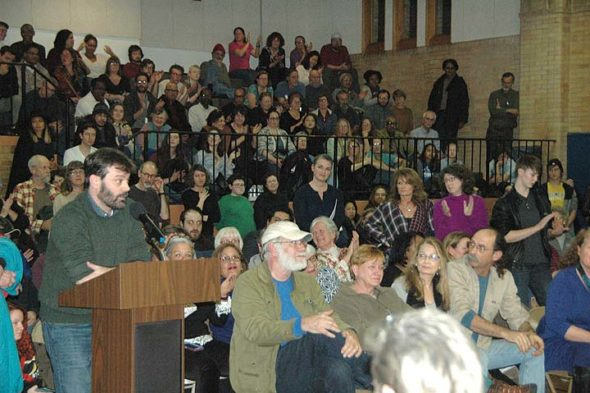 More than 250 villagers crowded into the Bryan Center gym Tuesday night for a special Council meeting about tensions with police at the New Year's Eve Ball Drop. About 40 people spoke, including Ian MacDonald, above. (Photo by Dylan Taylor-Lehman)