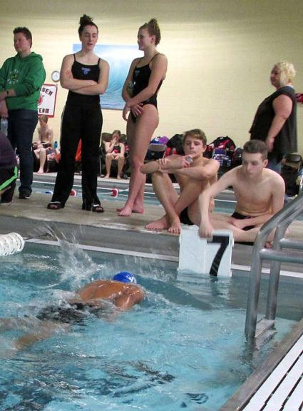 The YSHS Bulldog swim team set a few school records at their last two meets, including a first-place finish in the girls 400-yard freestyle relay at the Bethel High School Invitational on Dec. 18. Above, teammates Hannah Morrison and Olivia Chick watch as David Walker swims the 500 freestyle. (Submitted photo)
