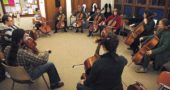 An informal cello technique forum at the Rockford Chapel social room on Monday evening. (photo by Matt Minde)