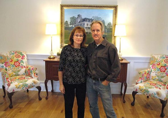 Libby and Jim Hammond stand in the lobby of the Mills Park Hotel, the hotel they built and manage. The hotel has increased the amount of places to stay locally since it opened in April 2016, and several area shop owners say its guests have increased business. (Photo by Dylan Taylor-Lehman)