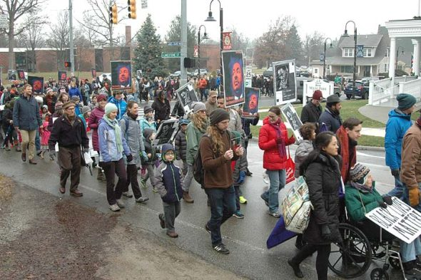 Several hundred community members marched in honor of Dr. Martin Luther King Jr. on Monday to the Foundry Theater on the Antioch College campus. (Photo by Matt Minde)