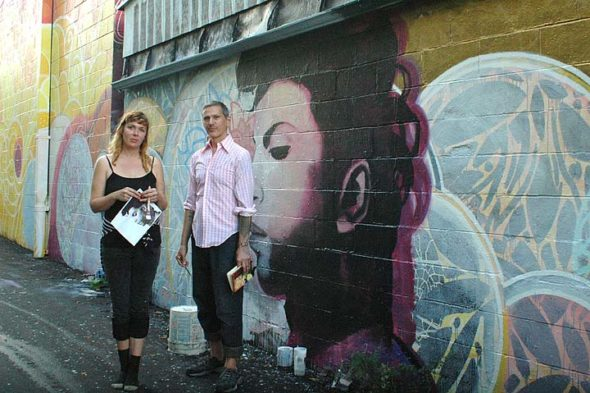 Sarah Dixon rendered legendary pop/funk/rock musician Prince, while Pierre Nagley continued work on an abstract study in yellows and oranges with white swirls in Kieth's Alley. (Photo by Matt Minde)