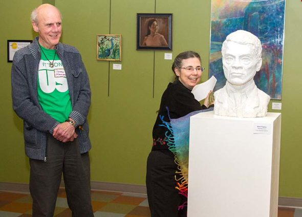 Sculptor Brian Maughan watched as Gallery Coordinator Nancy Mellon unveiled his new work, a bust of Gaunt. The sculpture was added to the YS Arts Council's permanent collection. (Submitted photo by Timothy Barhorst)