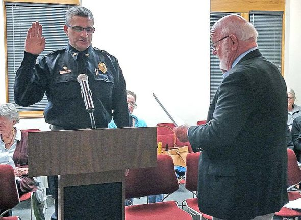 At Council's Feb. 6 meeting, Mayor David Foubert swore in Brian Carlson as the new Yellow Springs Interim Police Chief. (Submitted photo by Brian Housh)