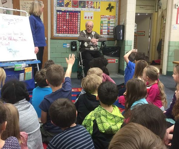 Students in Linnea Denman's kindergarten class at Mills Lawn got a special visitor on their 102nd day of school: Lloyd Kennedy, who is 102. Kennedy spoke with the students and shared what life was like when he was their age. (Submitted photo by Matt Housh)