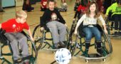 Above, from left, Nick Meister, Tyee Meeks and Ayla Arnold play soccer in sports wheelchairs brought over to the school from the Wright State Office of Recreation. (Photo by Robert Hasek)