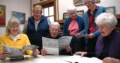 "Members of the Senior Center committee putting together ""Ripples,"" the center's annual literary journal by and about seniors, are seeking submissions from villagers. Shown above looking at past issues are, from left, Suzanne Patterson, Karen Wolford, Jane Baker, Fran LaSalle, Marianne Whelchel and Lee Huntington. Not pictured is committee member Sandy Love. (Photo by Diane Chiddister)"