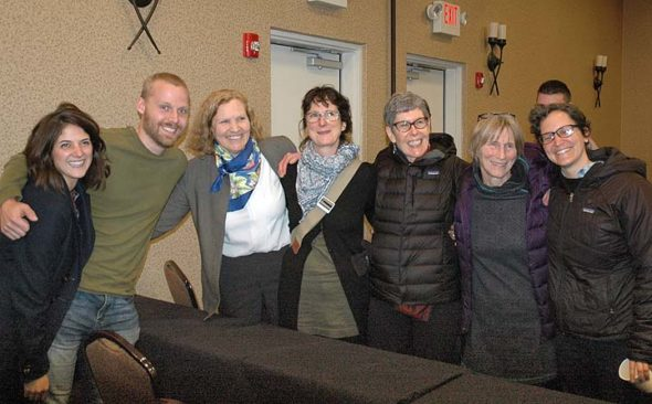 Community Solutions staff and boosters celebrated the nonprofit's purchase of 128 acres, or about half, of the Arnovitz farm moments after the land auction closed last Thursday, March 16. Pictured, left to right, are Julia and Tim Honchel, Executive Director Susan Jennings, Board member Kat Walter, Maureen Dawn, Liz Merksy and MJ Gentile. (Photo by Audrey Hackett)