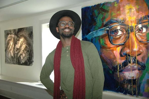 "Antioch College's Herndon Gallery is hosting ""Schizomaica,"" a show by Jamaican-born artist Kamar Thomas, currently visiting assistant professor of visual arts at Antioch. Up for a few more weeks, the show features 19 works in oil and charcoal, including ""Selfie 3,"" pictured here at right. A reception and painting demonstration will be held on Thursday, April 20, from 7 to 9 p.m. (Photo by Audrey Hackett)"