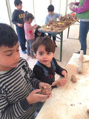 "Children at the Greek refugee camp Elpida (""hope"" in Greek) experimented with clay. Local artists Beth Holyoke and Kaethi Seidl provided materials, guidance and encouragement during a recent visit to the camp. (Submitted photo)"