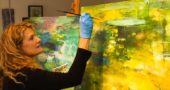 """A solo show by local artist Jennifer Rosengarten is opening at the Springfield Museum of Art this Saturday, April 22, with a reception from 5:30 to 7 p.m. """"Jennifer Rosengarten: Gardens & Ponds"""" will run through Jan. 7, 2018. Pictured here in her Dayton Street studio, the artist is increasingly well-known for her evocative paintings of the natural world. (Submitted photo by Bill Franz)"""