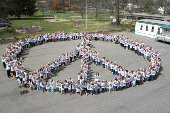 "For Peace Week at Mills Lawn School, the entire student body ""chose peace"" — gathering on school grounds to form a huge peace sign. (Photo by Suzanne Szempruch)"