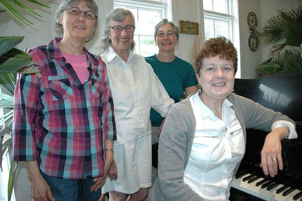 The board of the Yellow Springs Youth Orchestra Association is launching a new membership drive. Shown above are board members, from left, Carolyn Ray, Shirley Mullins, Liz Blakelock and Cammy Dell Grote at the piano. Not shown are Jeff Huntington, Scott Kellogg and Dennis Farmer. (Photo by Diane Chiddister)