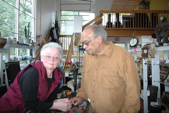 Gail Zimmerman and Mark Crockett have owned Rita Caz Jewelry Studio & Gallery since 1986. The couple is retiring, and their eclectic downtown store, selling everything from custom jewelry to African art to vintage guitars, will close its doors on May 20.  (Photo by Audrey Hackett)