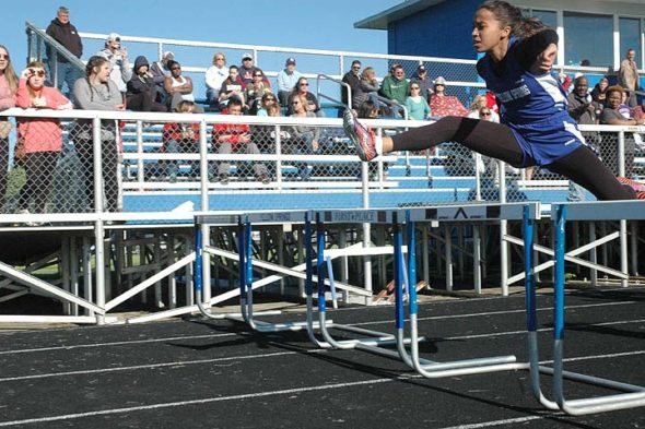 Yellow Springs High School hurdler Julie Roberts breaks ahead of the pack at the Bulldog Invitational held on Monday this week. Roberts took first place in both the 100-meter and 300-meter hurdles. (Photo by Dylan Taylor-Lehman)