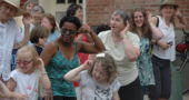 """The Senior Center will perform its fourth annual """"flash mob"""" dance on Wednesday, May 31; the community is invited to participate. Pictured are dancers from the first flash mob in 2014. (Photo by Suzanne Szempruch)"""
