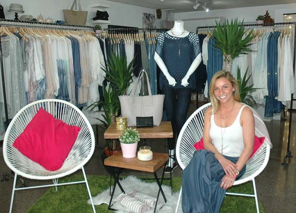 """Danyel Mershon, owner and clothes buyer at Wildflower Boutique downtown, will celebrate the official opening of her second store, Lady Loom, which she says is """"geared to a more elevated style."""" (Photo by Carol Simmons)"""