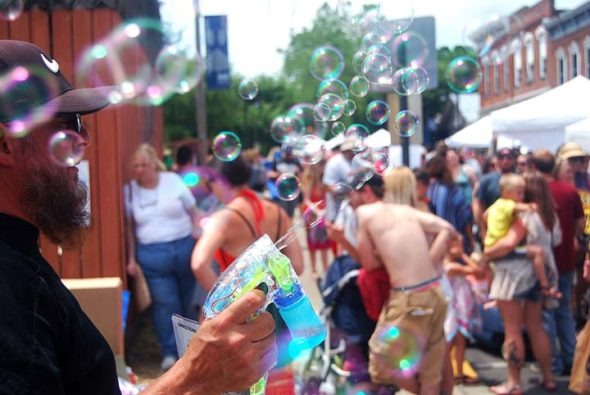Attendees of the 2017 Spring Street Fair seemed to be having a good time, including this bubble-blower on Dayton Street. (Photo by Aaron Zaremsky)