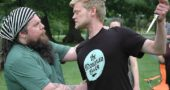 Aaron Saari (left), in the title role of Julius Caesar, and Jared Mola, as Brutus, rehearse the moment Caesar learns of his trusted comrade's ultimate betrayal, in preparation for Yellow Springs Theater Company's presentation of Shakespeare's political tragedy, July 14–15 and 21–22, under the stars on the grounds behind Mills Lawn School. (Photo by Carol Simmons)