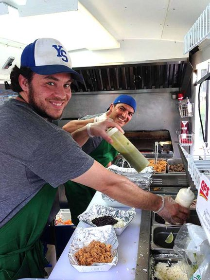 Miguel's Tacos, the village's newest food truck, serves up tacos and bowls made with fresh ingredients behind the Trail Tavern Thursdays through Sundays, 11:30 a.m. to 7 p.m. Shown above are the truck's owner, Miguel Espinosa, at left, and David Boyer. (Submitted Photo )