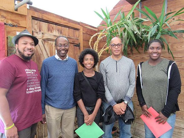 """Local historians and 365 Project members John Gudgel and Kevin McGruder are preserving and sharing village history in their collaborative encyclopedia project, """"Blacks in Yellow Springs,"""" as well as black history walking tours that involve local youth as guides. Pictured here, from left, are Steve McQueen, McGruder, Malaya Booth, Gudgel and Amani Wagner, all members of The 365 Project. (Submitted photo)"""