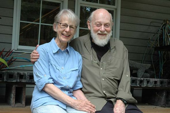 Poet, poetry translator and retired Antioch College professor of Japanese language and literature, Harold Wright has lived in Yellow Springs since 1973. He's made many dozens of trips to Japan over the years. Here, he's pictured with his wife, Jonatha, on the porch of their North Winter Street home. (Photo by Audrey Hackett)