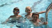 Monday afternoon local friends Edwin Harra, Ashby Lyons and Carson Funderburg enjoyed swimming at the pool on a rare day without showers. (Photo by Suzanne Szempruch)
