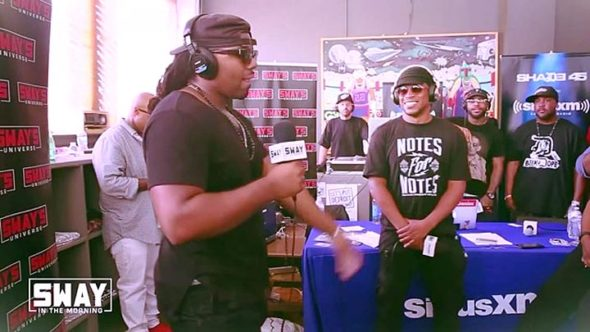 "Yellow Springs resident Issa Walker, aka Issa Ali, recently appeared on the influential Detroit radio program ""Sway in the Morning,"" delivering a spontaneous and well-received rap to an unfamiliar beat. Pictured here are Walker at the microphone, left, and hip-hop giant Sway Calloway, center, with members of the renowned Detroit rap group D-12 in the background. (Submitted photo)"