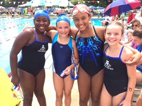 The final swim meet of the season for the Sea Dogs turned out to be a record-setting one for the team, with 12 team records and one league record being broken. Pictured are Joslyn Herring, Allie Hundley, Gini Meekin and Kaitlyn Uptegraft, who broke the team record for the 100-free relay in the girls ages 9–10 category. (Submitted photo)