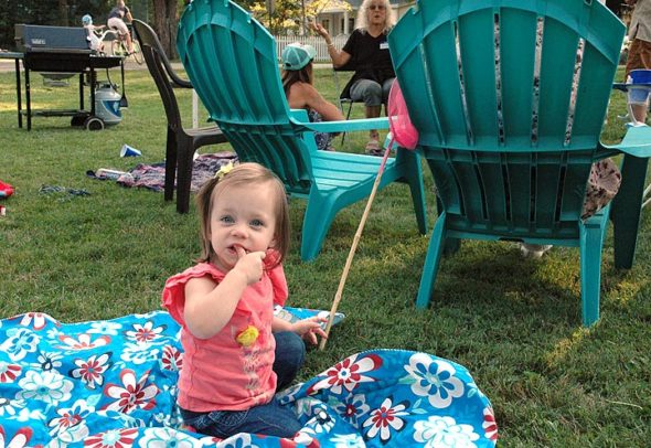 Best to start them young!  One of the youngest block party revelers — Juniper  DeVore Leonard, almost 2 — enjoyed her moment in the sun, and on a blanket, at the Whiteman/Davis Triangle party on Sunday, Aug. 27. (Photo by Carol Simmons)