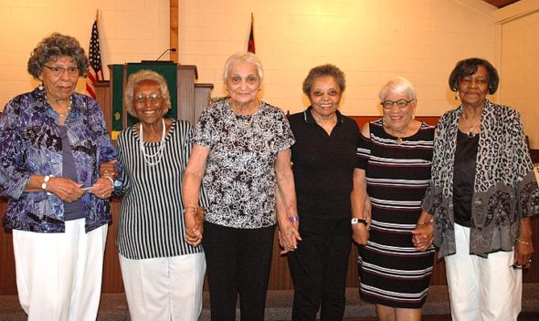 Six members of the Victorettes held hands and sang at Central Chapel A.M.E. Church on Sunday, Sept. 3, capping off this year's well-attended reunion. From left are Phyllis Jackson, Dorothy Allen, Marie Payton, Dorothy Boyce, Isabel Newman and Betty Ford. All were members of the singing and service group founded by Boyce in 1944 and active until 1946, with friendships that have lasted a lifetime. (Photo by Audrey Hackett)